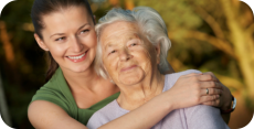an aged woman with her caretaker
